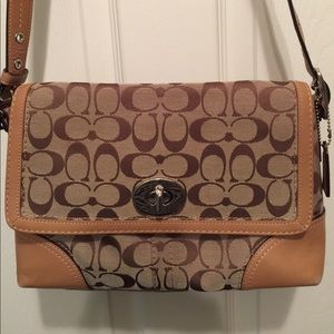 Coach logo signature fabric bag.